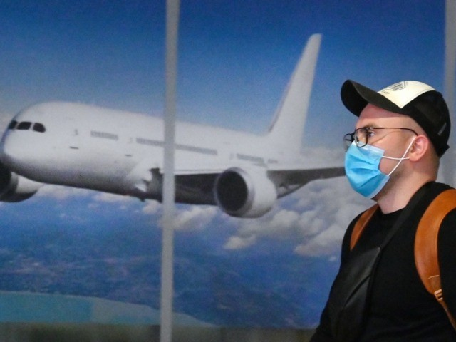 A Ukrainian tourist walks in the arrival hall of the Internatioanal Boryspil airport outside Kiev after his plane landed from China on January 30, 2020. - The first out of four special flights will be held on January 30, 2020 in order to evacuate hundreds of Ukrainian tourists from China …