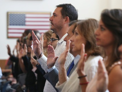 MIAMI, FLORIDA - AUGUST 16: Carlos Colome (C), originally from Cuba, joins with other people during a ceremony to become American citizens at a U.S. Citizenship & Immigration Services naturalization ceremony in a Miami Field Office on August 16, 2019 in Miami, Florida. The ceremony included 150 citizenship candidates from …