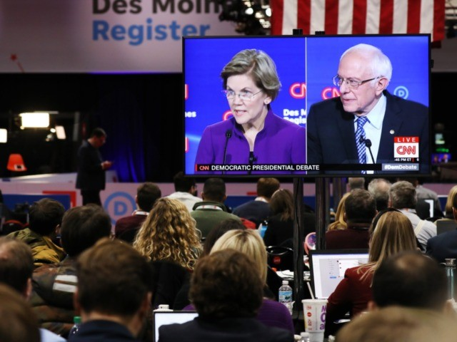 DES MOINES, IOWA - JANUARY 14: Members of the media watch the CNN Democratic Presidential Debate on January 14, 2020 in Des Moines, Iowa. Six candidates out of the field qualified for the first Democratic presidential primary debate of 2020, hosted by CNN and the Des Moines Register. (Photo by …