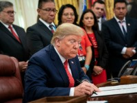 WASHINGTON, DC - NOVEMBER 26: U.S. President Donald Trump signs an executive order establishing the Task Force on Missing and Murdered American Indians and Alaska Natives, in the Oval Office of the White House on November 26, 2019 in Washington, DC. Attorney General William Barr recently announced the initiative on …