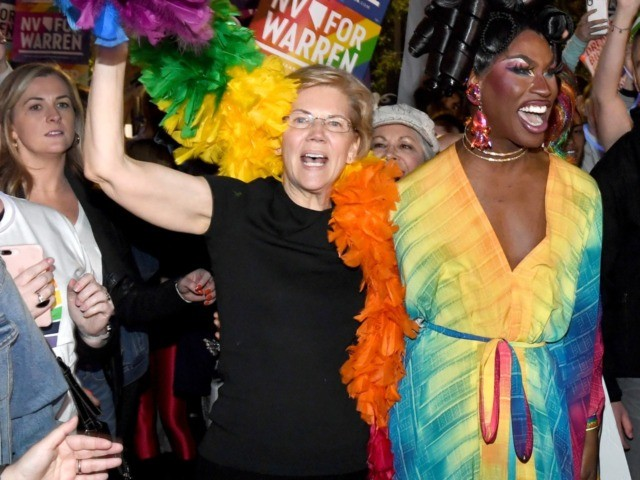LAS VEGAS, NEVADA - OCTOBER 11: Democratic presidential candidate and U.S. Sen. Elizabeth Warren (D-MA) (L) and drag queen Shea Coulee march with Warren supporters in the Southern Nevada Association of Pride Inc. 22nd annual PRIDE Night Parade on October 11, 2019 in Las Vegas, Nevada. Recent national presidential primary …