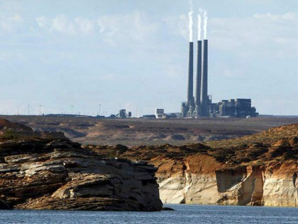 FILE - In this Sept. 4, 2011, file photo, smoke rises from the stacks of the main plant facility at the Navajo Generating Station, as seen from Lake Powell in Page, Ariz. The Navajo Nation company has ended its pursuit of a coal-fired power plant on the reservation and the …