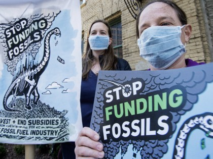 Demonstrators from Friends of the Earth, Oil Change International, Sierra Club, and Greenpeace, protest against Japanese financing of coal projects November 13, 2015 in front of the building that the Japan Bank for International Cooperation has offices, in downtown Washington, DC. The group called on Japan to stop publically financing …
