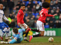 Manchester United's Dutch midfielder Tahith Chong (R) is fouled by Tranmere Rovers' English goalkeeper Scott Davies, giving away a penalty during the English FA Cup fourth round football match between Tranmere Rovers and Manchester United at Prenton Park in Birkenhead, north west England, on January 26, 2020. (Photo by Paul …