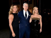 "NEW YORK, NEW YORK - OCTOBER 28: Jennifer Aniston, Apple CEO Tim Cook and Reese Witherspoon attend the Apple TV+'s ""The Morning Show"" World Premiere at David Geffen Hall on October 28, 2019 in New York City. (Photo by Theo Wargo/Getty Images)"