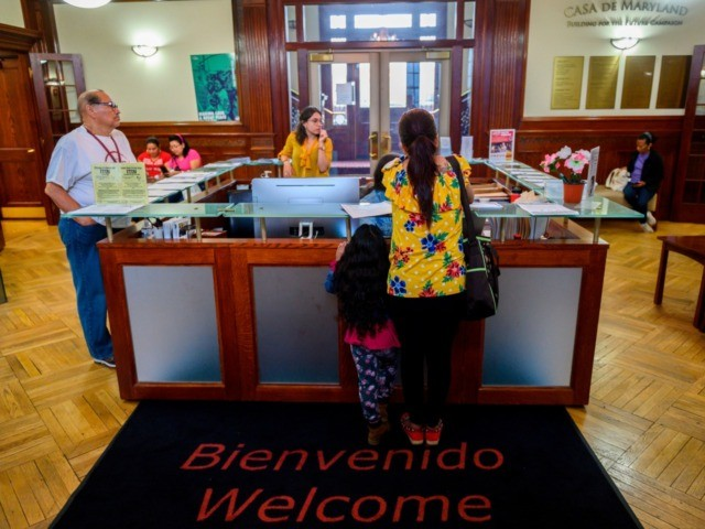 A woman and her daughter arrive at the office of the immigrants rights group CASA in Langley Park, Maryland on September 17, 2019. - Though she speaks little English, Yoana was calm when two officers from the US federal agency tasked with deporting undocumented people such as herself appeared outside …