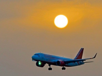 The Air India plane flying the inaugural trip from Lucknow, the capital of India's Uttar Pradesh, approaches to land at Najaf International Airport in the central Iraqi shrine city on February 14, 2019. - Lucknow, the capital of India's Uttar Pradesh, has a large population of Shiite Muslims. The holy …