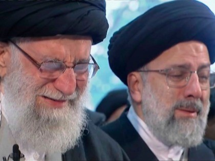 In this image taken from video, Iranian Supreme Leader Ayatollah Ali Khamenei, left, openly weeps as he leads a prayer over the coffin of Gen. Qassem Soleimani, who was killed in Iraq in a U.S. drone strike on Friday, at the Tehran University campus, in Tehran, Iran, Monday, Jan. 6, …