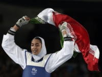 In this Aug. 18, 2016 file photo, Kimia Alizadeh Zenoorin of Iran celebrates after winning the bronze medal in a women's Taekwondo 57-kg competition at the 2016 Summer Olympics in Rio de Janeiro, Brazil. Zenoorin, Iran's only female Olympic medalist, said she defected from the Islamic Republic in a blistering …