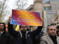 Iranians raise a placard during an anti-US rally to protest the killings during a US air stike of Iranian military commander Qasem Soleimani and Iraqi paramilitary chief Abu Mahdi al-Muhandis, in the capital Tehran on January 4, 2020. - Soleimani, the 62-year-old deputy commander of the Revolutionary Guards, will be …