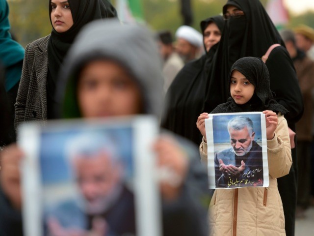 TOPSHOT - Protesters carry posters with the image of top Iranian commander Qasem Soleimani, who was killed in a US airstrike in Iraq, during a demonstration in Islamabad on January 3, 2020. - A US strike killed top Iranian commander Qasem Soleimani at Baghdad's international airport On January 3, dramatically …