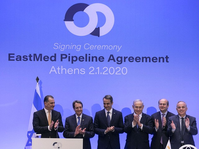 From left, Cypriot Energy Minister Georgios Lakkotrypis, Cypriot President Nicos Anastasiadis, Greece's Prime Minister Kyriakos Mitsotakis, Israeli Prime Minister Benjamin Netanyahu, Greek Energy Minister Kostis Hatzidakis, and Israel's Minister of Energy and Water Yuval Steinitz applaud following a signing ceremony, in Athens, Thursday, Jan. 2, 2020. The leaders of Greece, …