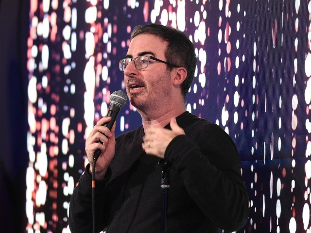 NEW YORK, NY - DECEMBER 11: John Oliver appears on stage during Scleroderma Research Foundation's Cool Comedy - Hot Cuisine New York 2018 at Caroline's on Broadway on December 11, 2018 in New York City. (Photo by Ilya S. Savenok/Getty Images for The Scleroderma Research Foundation)