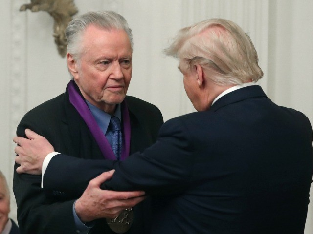 WASHINGTON, DC - NOVEMBER 21: U.S. President Donald Trump (R) presents actor Jon Voight with the National Medal of Arts during a ceremony in the East Room of the Whit House on November 21, 2019 in Washington, DC. (Photo by Mark Wilson/Getty Images)
