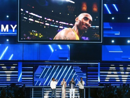 LOS ANGELES, CALIFORNIA - JANUARY 26: An image of the late Kobe Bryant is projected onto a screen while host Alicia Keys (2nd from L) and (from L) Nathan Morris, Wanya Morris, and Shawn Stockman of music group Boyz II Men perform onstage during the 62nd Annual GRAMMY Awards at …