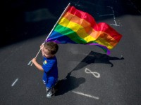 NEW YORK, NY - JUNE 26: A boy carries a flag during the New York City Pride March, June 26, 2016 in New York City. This year was the 46th Pride march in New York City (Photo by Eric Thayer/Getty Images)