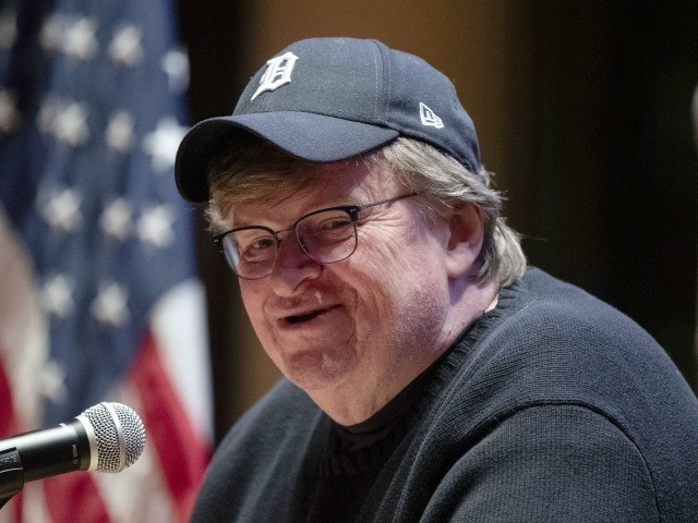 Filmmaker Michael Moore speaks during a campaign event at Grinnell College for Democratic presidential candidate Sen. Bernie Sanders, I-Vt., Thursday, Jan. 23, 2020, in Grinnell, Iowa. (AP Photo/Matt Rourke)