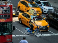 NEW YORK, NY - JULY 30: A cyclist navigates around taxi cabs on 7th Avenue in Midtown Manhattan on July 30, 2019 in New York City. As the nation's largest city tries to balance an increasing number of bicyclists along its streets, the numbers of bike riders killed and injured …