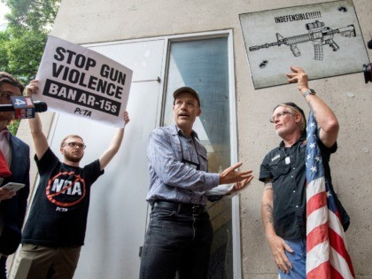 National Rifle Association member and Donald Trump supporter Jim Whelan, center, converses with protester David Lyles, 60, right, outside the NRA Annual Meeting on Friday, May 4, 2018, at the Kay Bailey Hutchison Convention Center in Dallas. (AP Photo/Jeffrey McWhorter)