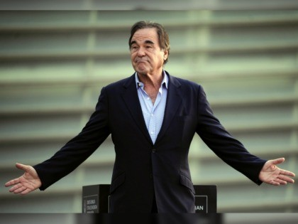 "US film director Oliver Stone gestures as he poses during the 61st San Sebastian Film Festival where he has presented his documentary film ""The Untold History of the United States"", in the northern Spanish Basque city of San Sebastian on September 24, 2013. AFP PHOTO/ RAFA RIVAS (Photo credit should …"