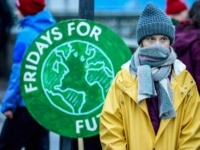 "Swedish environmental activist Greta Thunberg attends a climate strike arrangd by the orgatisation ""Fridays For Future"" outside the Swedish parliament Riksdagen in Stockholm, December 20, 2019. (Photo by Pontus LUNDAHL / TT News Agency / AFP) / Sweden OUT (Photo by PONTUS LUNDAHL/TT News Agency/AFP via Getty Images)"