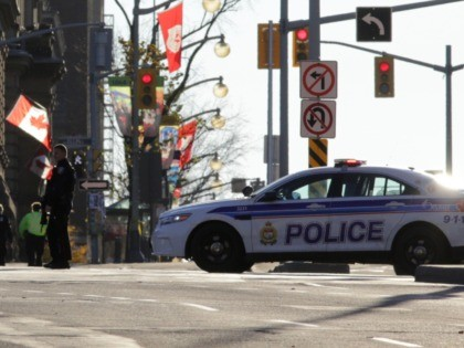 OTTAWA, CANADA - OCTOBER 22: Police officers secure the area near Parliament Hill on October 22, 2014 in Ottawa, Canada. At least one gunman shot and killed a Canadian soldier standing guard at the National War Memorial before entering the House of Commons inside the main Parliament building and opening …