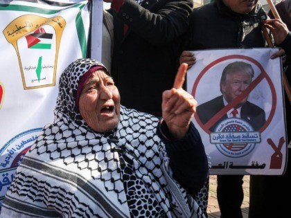 Palestinian demonstrators chant slogans against US President Donald Trump during a protest against his expected announcement of a peace plan, in Rafah in the southern Gaza strip on January 28, 2020. (Photo by SAID KHATIB / AFP) (Photo by SAID KHATIB/AFP via Getty Images)