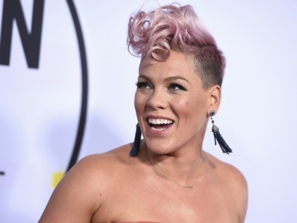 """Super Bowl Pink FILE - In this Nov. 19, 2017, file photo, Pink arrives at the American Music Awards at the Microsoft Theater in Los Angeles. NFL announced Monday, Jan. 8, 2018, that the pop star will perform """"The Star-Spangled Banner"""" before the Big Game on Feb. 4 at U.S. …"""