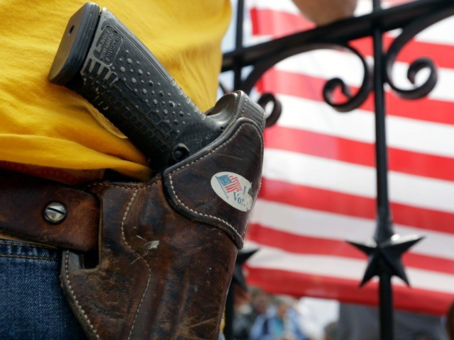 A man wears an unloaded pistol during a pro gun-rights rally at the state capitol, Saturday, April 14, 2018, in Austin, Texas. Gun rights supporters rallied across the United States to counter a recent wave of student-led protests against gun violence. (AP Photo/Eric Gay)