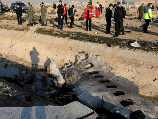 Debris is seen from an Ukrainian plane which crashed as authorities work at the scene in Shahedshahr, southwest of the capital Tehran, Iran, Jan. 8, 2020.Debris is seen from an Ukrainian plane which crashed as authorities work at the scene in Shahedshahr, southwest of the capital Tehran, Iran, Jan. 8, …