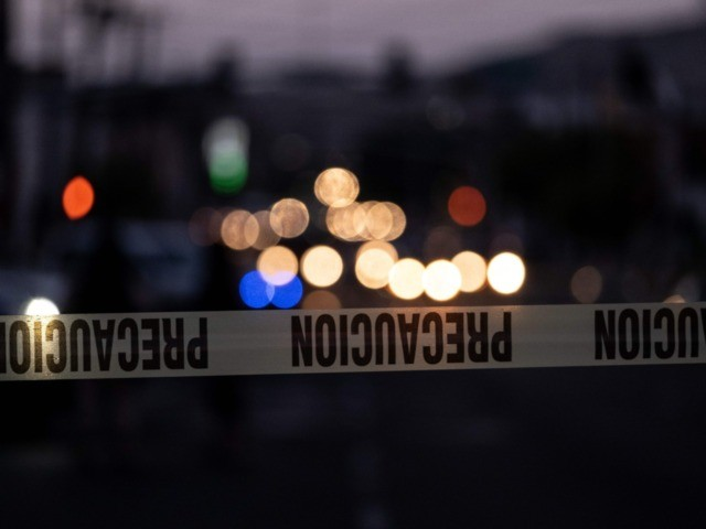 A police tape marks the perimeter of a crime scene where a man was killed by gun fire in downtown Tijuana, Baja California state, Mexico, on April 21, 2019. - Violence in Mexico, besieged by bloodthirsty drug cartels that also engage in fuel theft, extortion and kidnapping, reached a new …