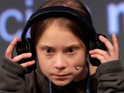Climate activist Greta Thunberg adjusts the headphones during a press conference in Madrid, Friday Dec. 6, 2019. Thunberg arrived in Madrid Friday to join thousands of other young people in a march to demand world leaders take real action against climate change. (AP Photo/Bernat Armangue)
