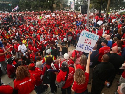 "Teachers and supporters march Monday, Jan. 13, 2020, during the Florida Education Association's ""Take on Tallahassee"" rally at the Old Capitol in Tallahassee, Fla. (AP Photo/Phil Sears)"
