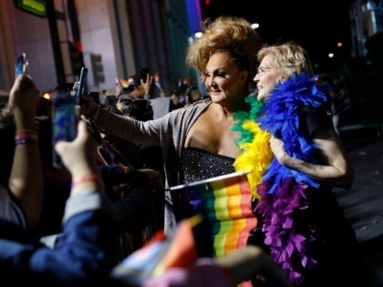 Democratic presidential candidate Sen. Elizabeth Warren, D-Mass., right, poses for a selfie at the Las Vegas Pride Parade, Friday, Oct. 11, 2019, in Las Vegas. (AP Photo/John Locher)
