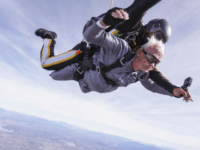 Stanley Rohrer of Valley Center, bottom, a double amputee who will be 90 on January 7th, skydives with tandem instructor Romulo Rangel high above the earth with Skydive Elsinore on January 3, 2020, in Lake Elsinore, California. (Courtesy of Skydive Elsinore)