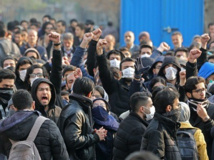 "Iranian students gather for a demonstration over the downing of a Ukrainian airliner at Tehran University on January 14, 2020. - AFP correspondents said around 200 mainly masked students gathered at Tehran University and were locked in a tense standoff with youths from the Basij militia loyal to the establishment.""Death …"