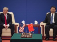 "US President Donald Trump (L) and China's President Xi Jinping attend a business leaders event inside the Great Hall of the People in Beijing on November 9, 2017. Donald Trump urged Chinese leader Xi Jinping to work ""hard"" and act fast to help resolve the North Korean nuclear crisis, during …"