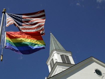 FILE - In this April 19, 2019, file photo, a gay pride rainbow flag flies along with the U.S. flag in front of the Asbury United Methodist Church in Prairie Village, Kan., United Methodist Church leaders are proposing creation of a separate division that would let more traditional denominations break …