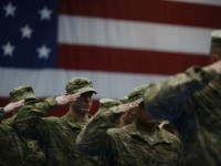 Soldiers from the U.S. Army's 3rd Brigade Combat Team, 1st Infantry Division, salute during the playing of the Star Spangled Banner during a homecoming ceremony in the Natcher Physical Fitness Center on Fort Knox on February 27, 2014 in Fort Knox, Kentucky. About 100 soldiers returned to Fort Knox after …