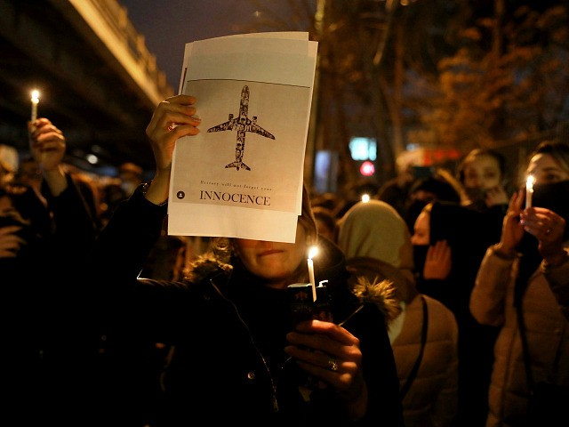 People gather for a candlelight vigil to remember the victims of the Ukraine plane crash, at the gate of Amri Kabir University that some of the victims of the crash were former students of, in Tehran, Iran, Saturday, Jan. 11, 2020. Iran on Saturday, Jan. 11, acknowledged that its armed …
