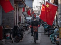 viral BEIJING, CHINA - JANUARY 31: A Chinese man wears a protective mask as he rides his bike in an alley on January 31, 2020 in Beijing, China. The number of cases of a deadly new coronavirus rose to almost 9700 in mainland China Friday, the day after the World …