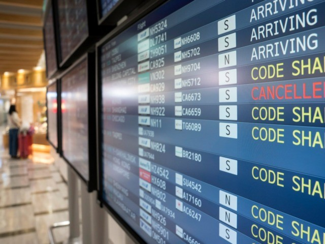 NARITA, JAPAN - JANUARY 24: A monitor displays airline departure information at Narita airport on January 24, 2020 in Narita, Japan. While Japan is one of the most popular foreign travel destinations for Chinese tourists during the Lunar New Year holiday this year, Japan reported two cases of Wuhan coronavirus …