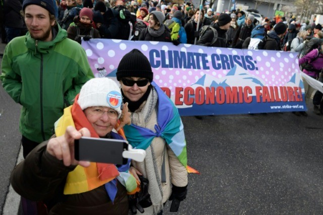 Climate activists march on Davos