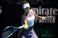 Resurgent Muguruza sets up Halep clash in Australian Open semi-finals