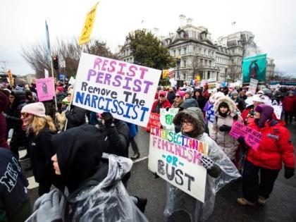 Participants take part in the Women's March near the White House, Saturday, Jan. 18, 2020, in Washington. (AP Photo/Manuel Balce Ceneta)