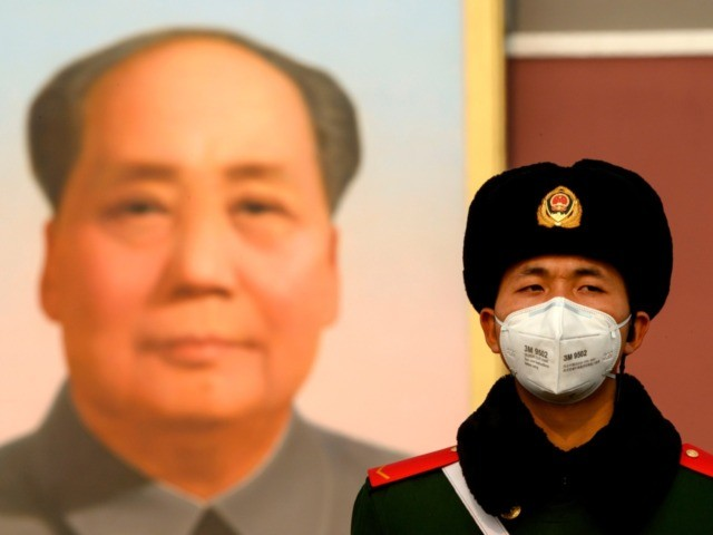 A paramilitary police officer wearing a protective facemasks to help stop the spread of a deadly SARS-like virus which originated in the central city of Wuhan, stand on guard in front of the portrait of late communist leader Mao Zedong at Tiananmen Gate in Beijing on January 28, 2020. - …