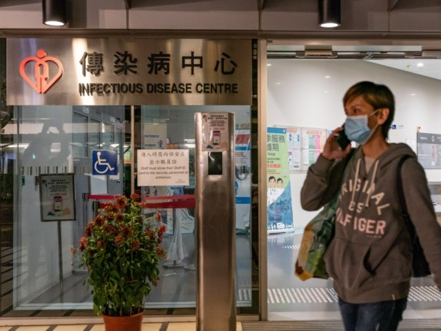 HONG KONG, CHINA - JANUARY 22: A woman wearing a face mask exits the Infectious Disease Centre of Princess Margaret Hospital on January 22, 2020 in Hong Kong, China. Hong Kong reported its first two cases of Wuhan coronavirus infections as the number of those who have died from the …