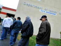People wait in line outside of the State of California Department of Motor Vehicles (DMV) in Los Angeles, California. (ROBYN BECK/AFP/Getty Images