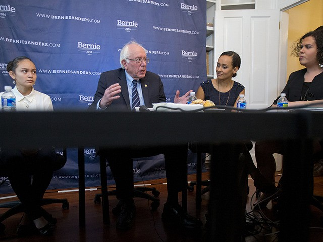 "FILE - In this Dec. 7, 2015, file photo, Democratic presidential candidate, Sen. Bernie Sanders, I-Vt., center, discusses his ""Family First"" immigration plan, during a live broadcast from his campaign office in Washington. Joining Sanders are from left to right, Santos Guevara Amaya, who immigrated from El Salvador; Erika Andiola, …"