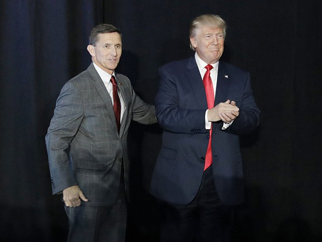 FILE - In this Sept. 29, 2016, file photo, retired Gen. Michael Flynn, left, introduces then-Republican presidential candidate Donald Trump at a campaign rally, in Bedford, N.H. Flynn, the former National Security Adviser at the center of multiple probes into Russia's interference in the 2016 presidential election, is seeking sanctuary …
